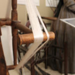 Displayed spinning wheel from Mansfield Historical Society's collection.