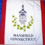 Mansfield's Town Flag.  It features an image of the front entrance of the former Town Office Building (now the Mansfield Historical Society Museum) surrounded by mulberry leaves, representing Mansfield's renowned early silk industry.
