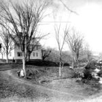 The home of the Eaton family (587 Storrs Road) in Mansfield Center.  It was built by Roswell Eaton in 1797.  At the right of the photograph is the stream that William Eaton diverted to create the cranberry bog.