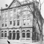 The arrow shows the location of O'Neill's millinery in the United Bank Building on Main Street, Willimantic. (Photograph courtesy of the Windham Textile & History Museum)