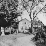 The George Clark homestead in 1912. The young girl in the photograph is Mae Clark.